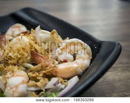 yummy shrimp on black plate at lunch