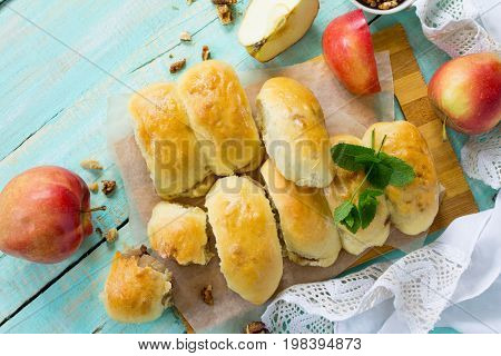 Homemade Apple Pies With Fresh Apples And Walnuts From Yeast Dough On A Kitchen Wooden Table. Flat L