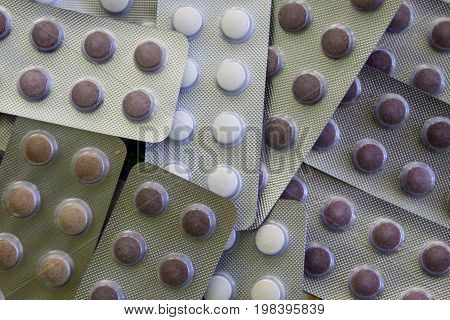 Medicine pills packed in blisters pack close-up