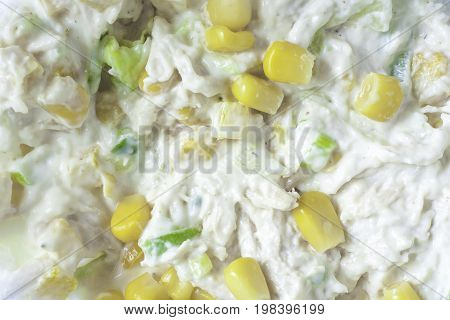 Close up of chicken and sweetcorn mayo sandwich filling