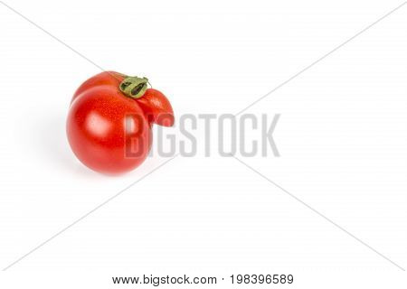 Deformed aberrant abnormal anomalous red tomato on a white background. Deformation due to cold weather during ovulation. Strange forms grown mutated tomato. poster