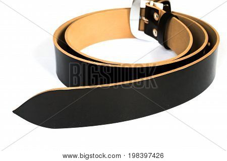 black shiny belt with buckle isolated on white background