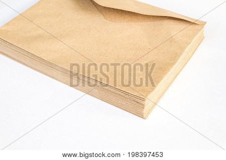stack of Brown craft envelope for mailing isolated on white background