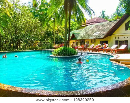 Railay, Krabi, Thailand - February 02, 2010: The people resting at pool at Sand Sea Resort at tropical Thailand island at Railay, Krabi, Thailand on February 02, 2010