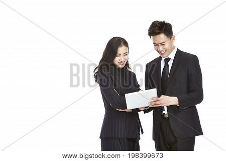 young asian businessman and businesswoman working together using mini digital tablet isolated on white background.