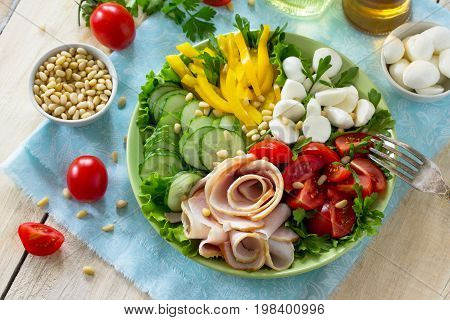 Summer Salad With Vinaigrette Salad Dressing. Salad With Ham, Fresh Vegetables, Pine Nuts And Mozzar