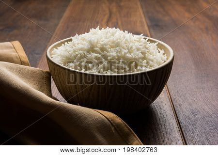 basmati rice in a ceramic bowl, indian white and long basmati rice cooked and served in bowl, selective focus