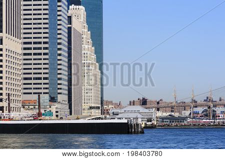 New York City USA - February 1 2009: East River view showing Pier 17 and 120 Wall Street