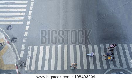 the group of people walk in the crosswalk business street city at the rush hour (Aerial photo top view)