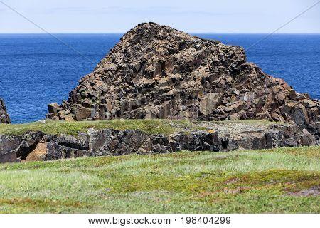 rock formation by Atlantic Ocean near Bonavista, Newfoundland poster