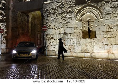 JERUSALEM ISRAEL - AUGUST 03 2017: Car leaves the Zion gate of the old city of Jerusalem