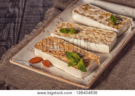 Nougat with honey and nuts on the old table
