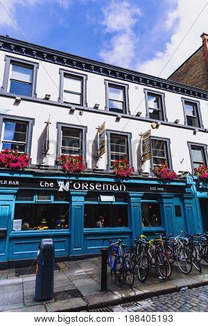 DUBLIN IRELAND - July 15th 2017: detail of the pubs and streets in the Temple Bar district in Dublin Ireland (with unidentified people)