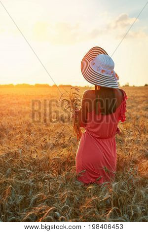 Beautiful Young Woman With Brown Hear Wearing Rose Dress And Hat Enjoying Outdoors Looking To The Su