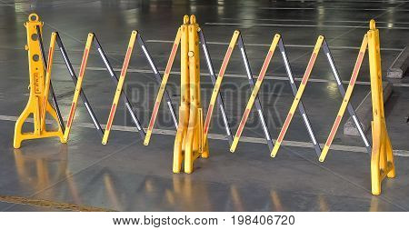 Automotive Safety Concepts Yellow Portable Plastic Folding Safety Barrier Suitable to Restrict Access in Building Road or Dangerous Area.