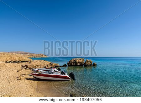 Sunny Sand Beach And Stones On Island Tiran In Egypt, Red Sea, Blue Sea With Yachts