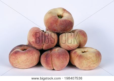 Flat peaches isolated on a white background