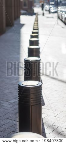 Line of protective bollards along New York street