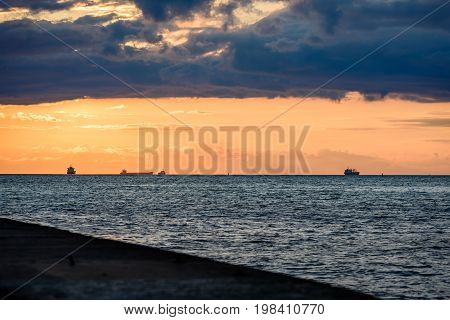 Sea Ships On The Horizon In Sunset