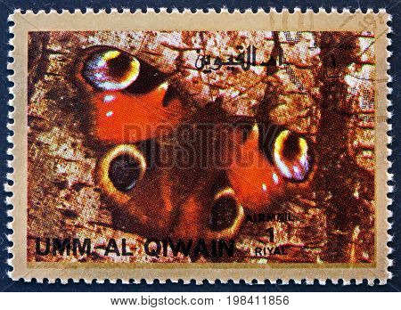 UMM AL-QUWAIN - CIRCA 1972: a stamp printed in the Umm al-Quwain shows Butterfly Insect circa 1972
