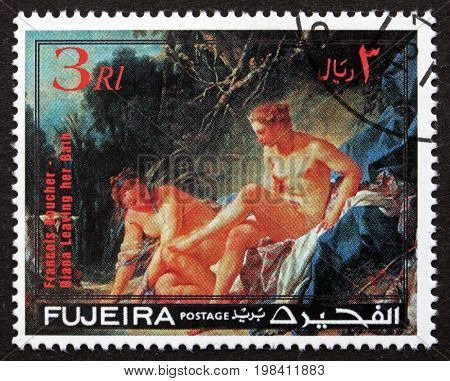 FUJEIRA - CIRCA 1971: a stamp printed in Fujeira shows Diana Leaving her Bath Painting by Francois Boucher. Diana was goddess of the hunt circa 1971