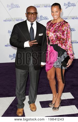 LOS ANGELES, CA - FEB 8: Producer L.A. Reid (L) and wife Erica Holton arrive at the Justin Bieber: Never Say Never premiere at Nokia Theater L.A. Live on February 8, 2011 in Los Angeles, California.