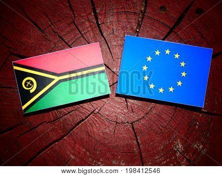 Vanuatu Flag With Eu Flag On A Tree Stump Isolated