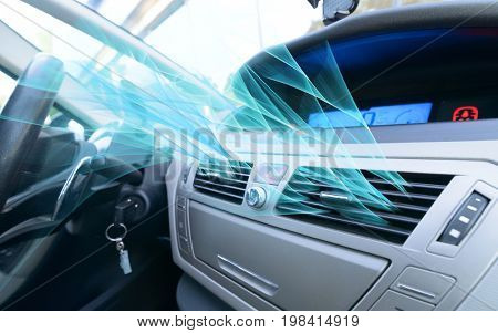 Driver hand tuning air ventilation grille, fresh air is coming out