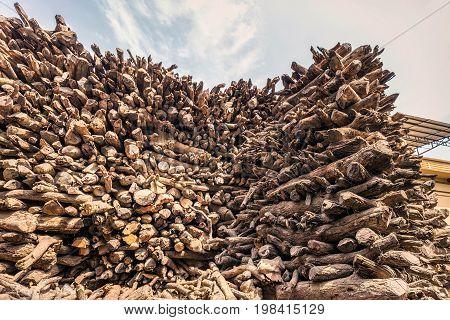 Pile of wood used at ghats crematorium of Varanasi, India.