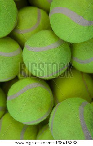 Full frame shot of fluorescent yellow tennis balls