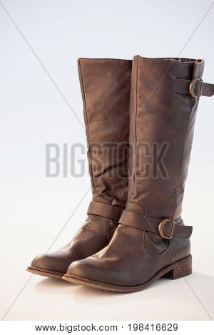 Close-up of wellington boot pair against white background