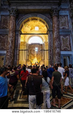Rome, Vatican, Italy - July, 2, 2017:  tourists in Saint Peter's Dome in Vatican near the sculpture of Michelangelo Buonarroti