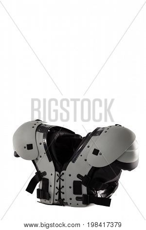 Close up of gray chest protector against white background