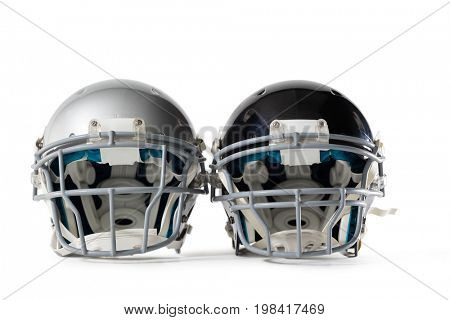 Close up of sports helmets on white background