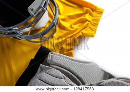 Close up of sports jersey with helmet on white background