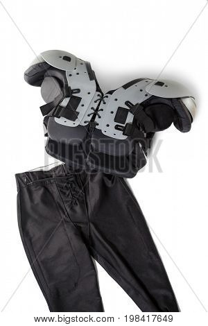 High angle view of chest protector with pant on white background