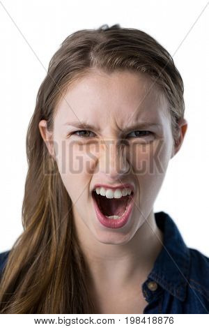 Portrait of teenage girl shouting against white background