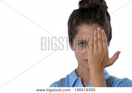Teenage girl covering her eyes. See no evil concept