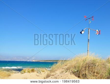 Santa Maria beach with windbreak anemometer on Paros island