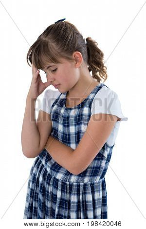 Close-up of sad girl standing against white background