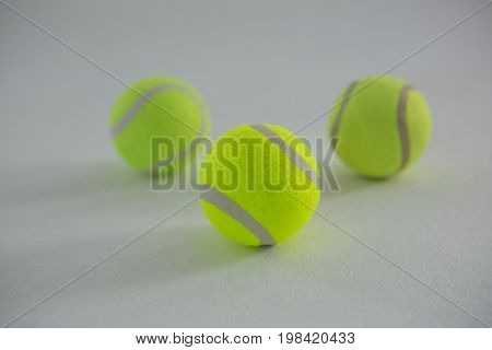 Close up of fluorescent tennis balls on white background