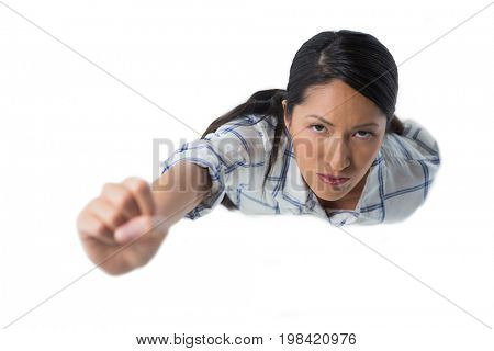 Portrait of woman pretending to be a superwoman against white background