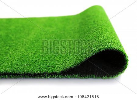 Artificial grass mat on white background