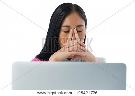 Tired woman relaxing against white background