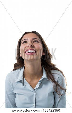 Close-up of thoughtful female executive against white background