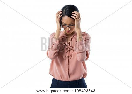 Close-up of tensed female executive standing against white background