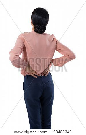 Female executive suffering from backache against white background