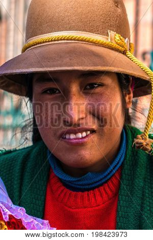 Andean indigenous woman in traditional inca customs, Cusco, Peru