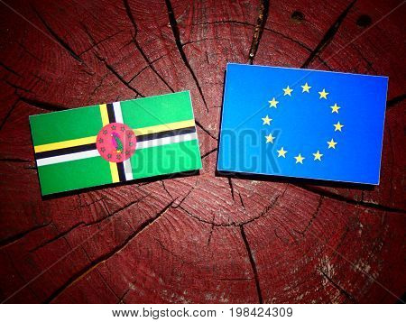 Dominica Flag With Eu Flag On A Tree Stump Isolated