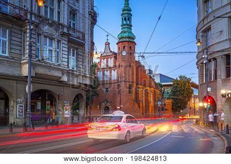 BYDGOSZCZ, POLAND - AUGUST 1, 2017: Traffic lights in Bydgoszcz city at dusk, Poland. Bydgoszcz is the eighth-largest city in Poland with beautiful neo-gothic and neo-baroque architecture.